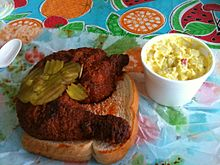 Nashville-style hot chicken with traditional accompaniments