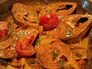 Ilishi maachha curry with ginger mustard garlic paste in tomato seasoning in Odisha style in Oriya cuisine.