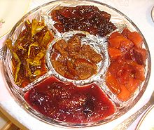 Five varieties of fruit preserves (clockwise from top): apple, quince, plum, squash, orange (in the center)
