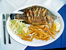 "Redbelly tilapia, Tilapia zilli (""St. Peter's fish) served in a Tiberias restaurant"
