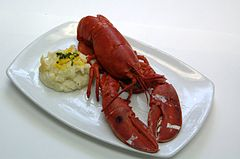 Steamed whole lobster, with claws cracked and tail split