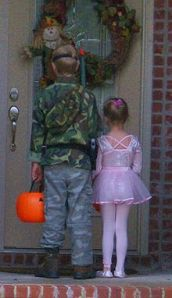 Two children trick-or-treating on Halloween