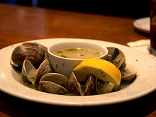 Yummy bowl of steamed clams in broth