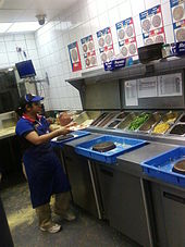 Dominos  A makeline at a Domino's