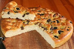 Homemade Focaccia with olives and herbs