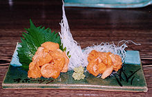 Sea urchin (uni) served Japanese style as sashimi, with a dab of wasabi