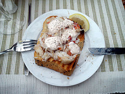 Crab meat from crab claws, atop toast