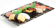 Sushi in shops are usually sold in plastic trays.