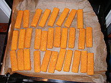 Baked fish fingers on baking paper