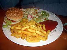 Order from a vegetarian deli: veggie burger with french fries and salad