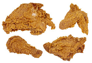 A chicken breast, wing, leg and thigh fried
