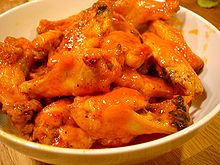 A bowl of hot Buffalo wings
