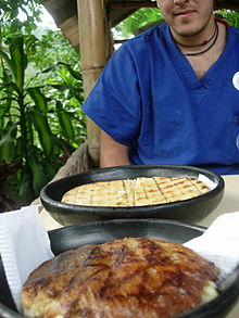 Colombian arepas: choclo (front) and quesito (back)