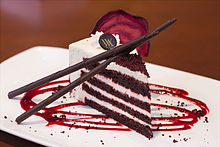 Four-layer slice of red velvet cake