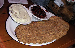 Chicken fried steak, served with mashed potatoes