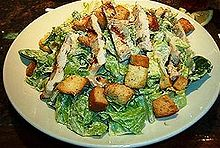 One of the most common Caesar salad variations, shown here topped with grilled chicken