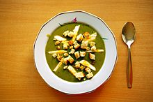 Sorrel soup with egg and croutons; Polish cuisine.