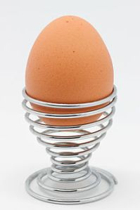A boiled egg, presented in an eggcup