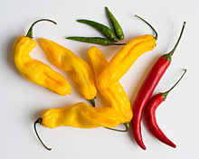 Green bird's eye, yellow madame Jeanette, and red cayenne peppers