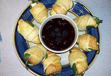 Jalapeño peppers wrapped in crescent rolls