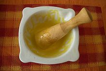 Aioli of garlic, salt, egg, and olive oil in a mortar