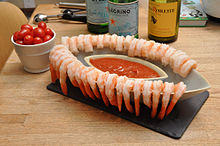 A shrimp cocktail served with cocktail sauce