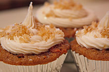 Carrot cake cupcakes with candied ginger icing