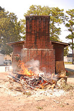 A wood-fired barbecue pit.