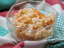 Eastern European style sauerkraut pickled with carrots and served as a salad