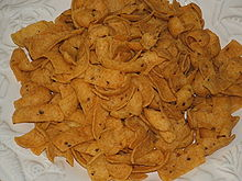 Flavored corn chips such as Fritos are an outgrowth of traditional fried tortilla chips.