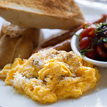 Scrambled eggs with grated cheese.