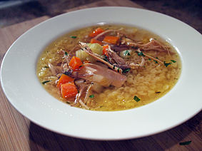 A classic preparation of chicken noodle soup made with a stewing hen and flavored with thyme and black pepper