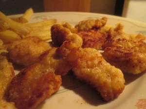 spicy-cajun-style-breaded-alligator-bites-w-baked-fries-and-fren-011