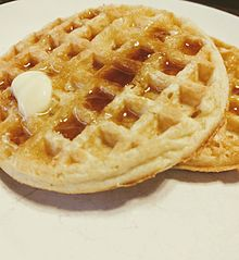 Two Eggo toaster waffles with butter and syrup
