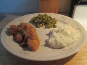 baked chicken breast strips w mashed potatoes and cut green beans