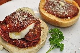 A meatball sandwich prepared using a bun