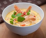 A seafood chowder prepared with shrimp andcorn