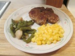 Cumin Spiced Pork Chops Golden Hominy and Cut Green Beans and Potatoes