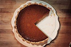 Pumpkin pie, with two slices removed