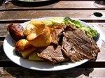 A Sunday roast consisting of roast beef, potatoes, vegetables, and Yorkshirepudding