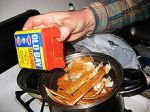 Putting Old Bay on crablegs.