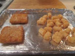 Fish Sandwich Fillet Sandwich tater tots on baking sheet