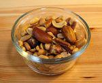 Brazil nuts ride on top ofpeanuts