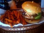A buffalo burger and sweet potatofries